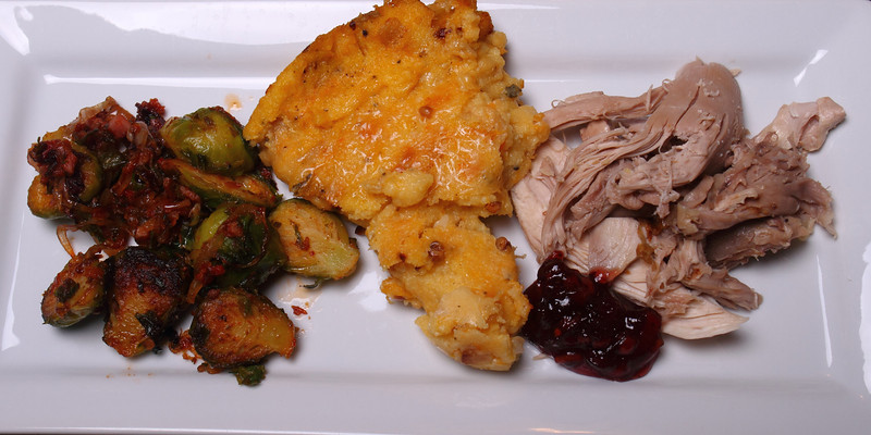 Classic Roast Turkey served with Smoked Polenta & Butternut Squash with Gouda , Parmesean and Toasted Pine Nuts; Pan Seared Brussels Sprouts with Shallots & Pancetta.