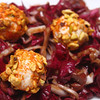 Radicchio with Pistachio Paprika Crusted Goat Cheese Balls & Kalmata Olive Balsamic Dressing.