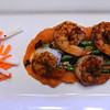 Ancho chili rubbed shrimp, cooked at the table on a hot (425 degree) Himalayan salt block, served with fresh from the garden asparagus, garlic and black sesame seeds sauteed in sesame oil, all on a bed of carrot ginger puree, along with jicama carrot slaw.