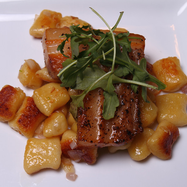 Seared Pork Belly with Potato Gnocchi sautéed with Shallots & Garlic.