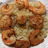 Shrimp stock risotto topped with pan seared scallops and shrimp (seasoned with garlic & a bit of Thai chili).