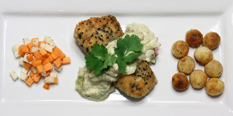 Friday Fish Fry: Haddock crusted with Panko & Black Sesame Seeds topped with a dollop of Avocado Sauce, Sauteed Potato Buttons, Jicama & Carrot Slaw.