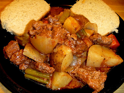 Beef stew cooked in new cast iron Dutch Oven.  Served with homemade bread.