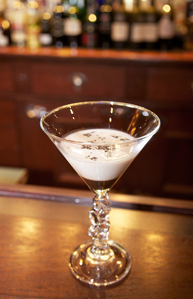 Coco Martini, Vanilla Vodka, Godiva white chocolate liqueur and White Creme de Cacao, a splash of milk layered with chocolate sauce.
