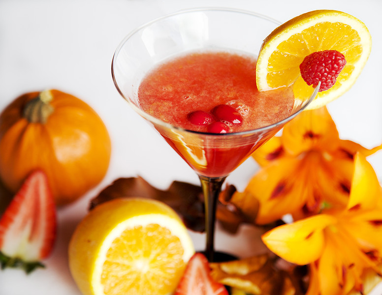 Mountain Cosmo, Fresh orange slices, cranberry juice, vodka, amaretto, and shaken on ice.