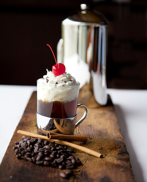 Black Forest Coffee, Dark Creme De Cacao, Chambored, and Stoli Vanilla Vodka, whip cream, chocolate flakes and a cherry