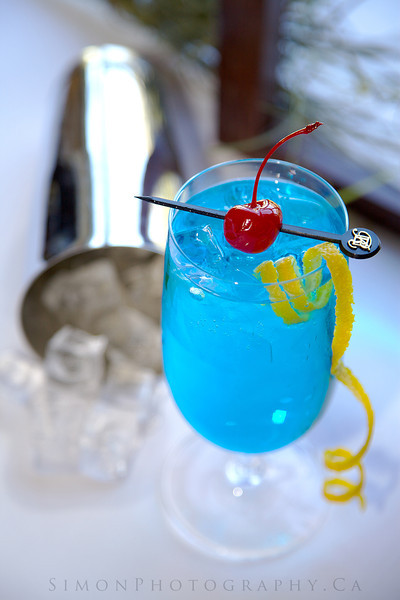 Blue Haze, Tequila, Blue Curacao, Triple Sec, lime juice, simple syrup and soda water.