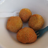 A specialty of the region:  Large green olives pitted, stuffed with minced veal, and deep fried.  They are sort of like edible cannonballs, but good.