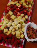 "Halloween treats.  At our house, we give up candy at Halloween for CHOCOLATE FONDUE.  This year's platter includes raspberries, pound cake, bananas, strawberries, apples (locally grown, organic - <a href=""http://www.charliesapples.com"">http://www.charliesapples.com</a>), and spiced almonds."
