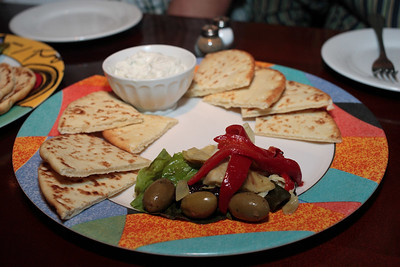 assorted pita bread, olives, and tzatziki dipping sauce