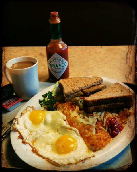 Breakfast of fried eggs, linguiça and hash browns at Nation's Giant Hamburgers in Berkeley, California on Sunday, February 24, 2013. Shot with Apple iPhone 3Gs with Camera Awesome app and More Cowbell filter applied. Photo by David Yee. ©2013