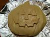 Jack-o-lantern baked brie