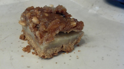 Apple bars with peanut butter caramel topping.