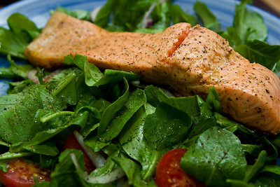 Pan seared salmon on a bed of arugula.