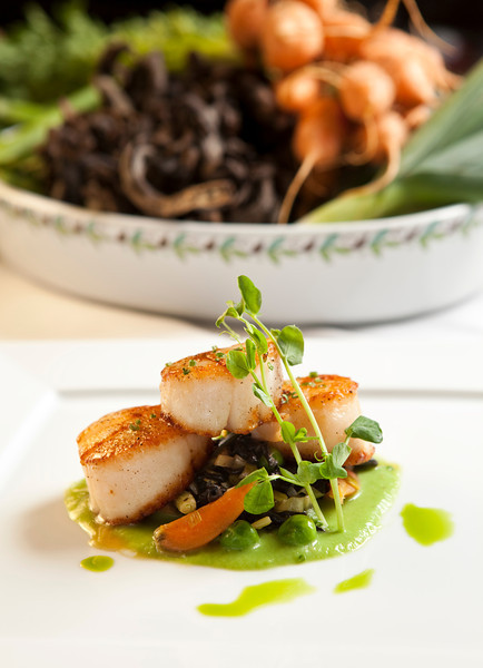 Suateed diver scallops with English pies, heirloom carrots and black trumpet mushrooms in the Meritage kitchen