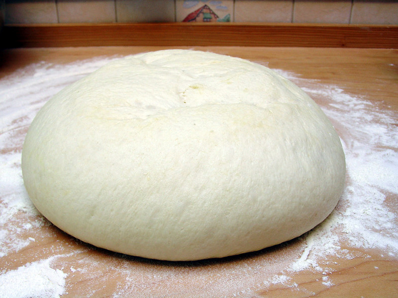 After second rise, dough is tipped out of bowl onto floured board.