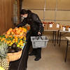 """First time customer Julie Zanotta of Groton, who found out about the weekend market on Facebook, shops for """"everything"""" at the former Kirk farm at Wyman Road and Nashua Road in Groton, where Chad Spiczka sells fresh produce on Saturdays and Sundays through the winter. (SUN/Julia Malakie)"""