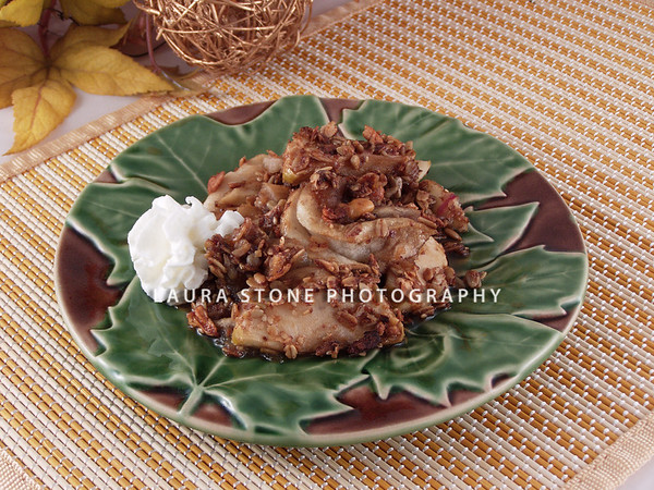 Apple crisp with whipped cream.