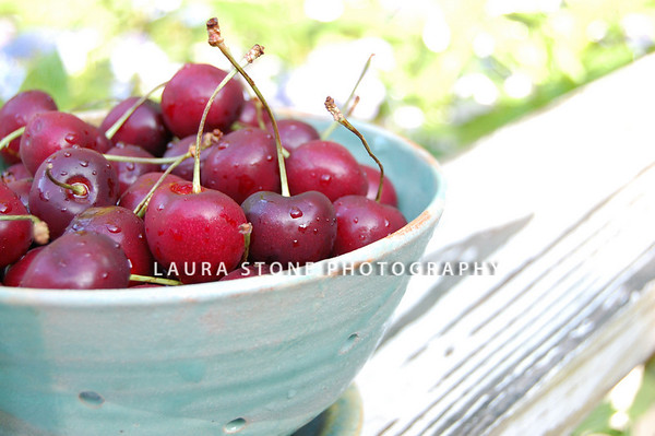 Fresh cherries in a pottery bowl