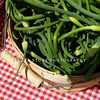 Garlic scapes for sale at a farmers market