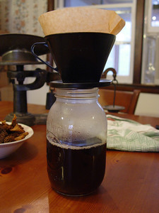 Filtering the morel soaking liquid through a coffee strainer to remove grit