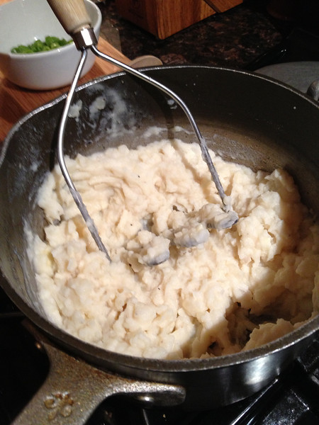 Do it right! Use a real masher and leave a few lumps! This masher was my Mom's.