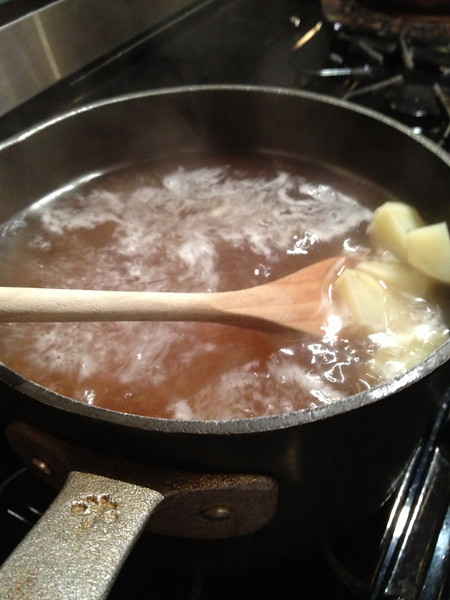 Peel, chop and cook the taters with salt & pepper- I like to add chicken stock to the water as well. Half water and half stock.