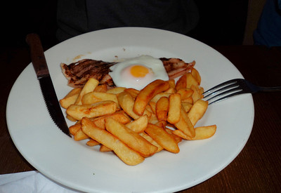 "5oz Gammon steak, served with chips, peas and a fried egg on top. £4.09.  Served in ""The Hungry Horse"" 01/03/11"