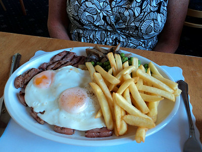 "100z Gammon Steak - Chargrilled prime gammon steak served with a brace of eggs, pineapple, mushrooms, chips and peas. £12.95.  Served in ""The Babbacombe Inn"" in Torquay  05/07/14"