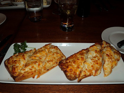 """Garlic Cheese Toast - Topped with a blend of three cheeses and toasted.  Served in """"The Keg"""" in London, Ontario  30/01/44"""