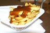 Frites topped with currywurst sauce.