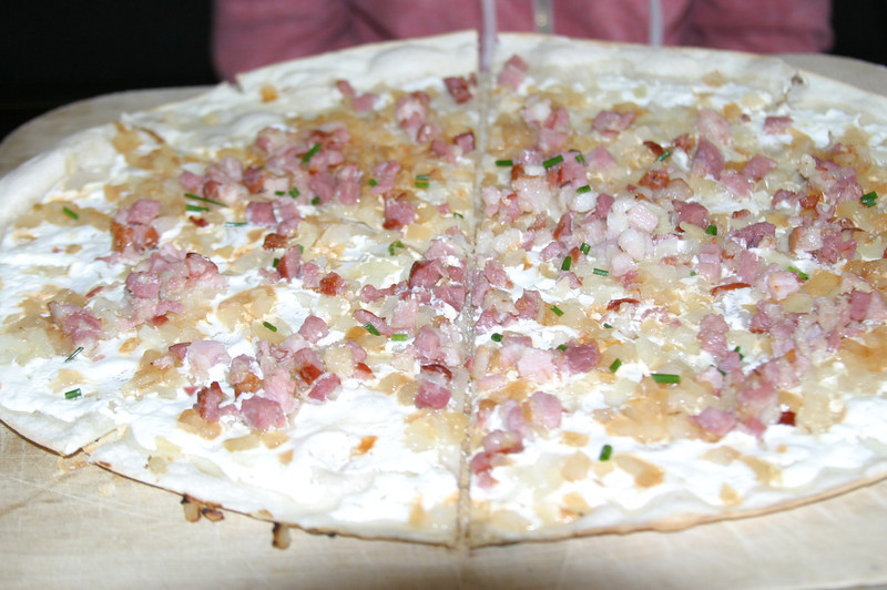Flammkuchen (German Pizza).  Caramelized Onions, Creme Fraiche and Lardons (Bacon) from the Mangold Restaurant.in Düsseldorf.