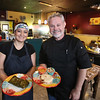 Co-owners  Marina Orellana and Dave MacDonald of North Chelmsford with tamale and pupusas at Girasol Central American Food in Chelmsford. (SUN/Julia Malakie)