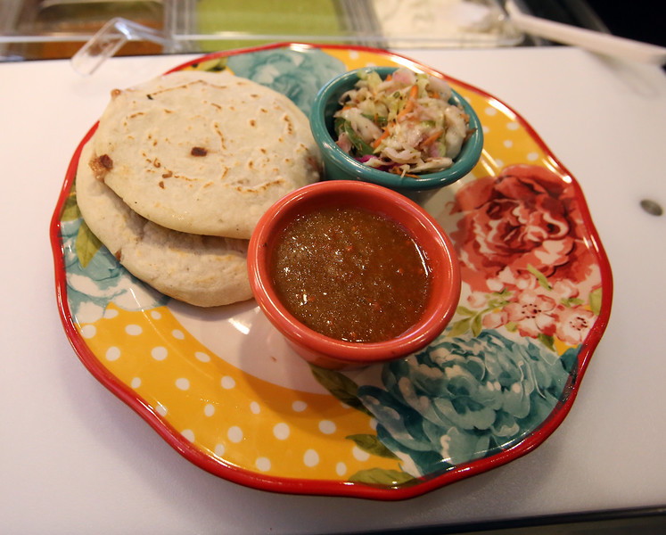Pupusas with side dishes at Girasol Central American Food in Chelmsford. (SUN/Julia Malakie)