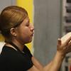 Lucia Echeverria of Lowell makes pupusas at Girasol Central American Food in Chelmsford. (SUN/Julia Malakie)