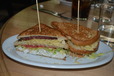 Chicken salad club, with pastrami bacon and a layer of potato chips
