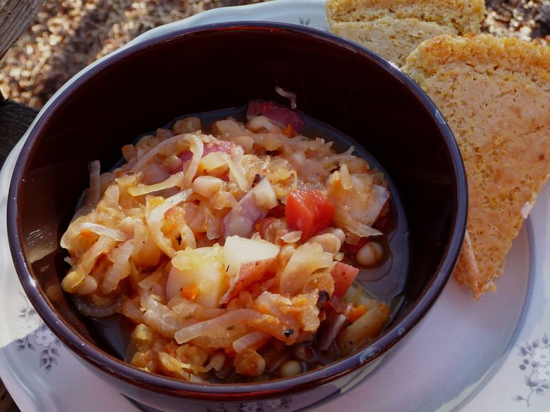 """<h1>Sweet and Sauerkraut Soup</h1> This is a most unique soup/stew from Nava Atlas' <b><a href=""""http://www.amazon.com/Vegan-Soups-Hearty-Stews-Seasons/dp/076793072X/ref=sr_1_1?ie=UTF8&s=books&qid=1294068366&sr=1-1"""">Soups and Hearty Stews for All Seasons</a></b>.  Wonderful combination of ingredients including sauerkraut, apples, tomatoes, and potatoes.  The sauerkraut adds a most unique undertone of flavors ... when I served it to my husband, he said, """"Hmmm, this tastes like there is wine in here.""""  Great for a cold and/or damp winter's day meal!  Gluten free and fat free.  The recipe calls for 3 Tbsp. of oil for sauteing which can easily be omitted (steam stir fry instead).  It also calls for the optional addition of tempeh and/or soy sausage links, which would add associated gluten and fat.  Served with cornbread."""