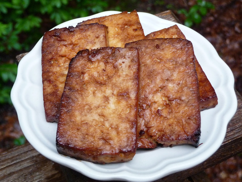 """<h1>Soy Glazed Tofu</h1> Another great recipe from Robin Robertson's <u><b><a href=""""http://www.amazon.com/gp/product/0470085029/ref=as_li_tf_tl?ie=UTF8&tag=mayoowbr-20&linkCode=as2&camp=217153&creative=399353&creativeASIN=0470085029"""">1,000 Vegan Recipes</a></b></u>.   This one is quick and easy to fix up ... it needs 30 minutes to marinate and 30 minutes to bake, but your actual working time is only around 15 minutes to slice and press the tofu and mix up the marinade.  This is great hot, right out of the oven; at room temp; or cold.  So good that I have to make sure I don't eat the whole, entire recipe at one sitting!!  Thanks to Robin for allowing her book to be part of Google Books Search, <b><u><a href=""""http://books.google.com/books?id=jeFz24WOHq8C&lpg=PA245&vq=soy glazed tofu&dq=soy glazed tofu&pg=PA283#v=onepage&q&f=false"""">recipe is here</a></u></b>."""