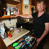 MaryBeth Bowen of Lowell, who has celiac disease, and the food, kitchenware and appliances she needs to eat a gluten-free diet. These kitchen cabinets and drawers are just for things she uses. (SUN/Julia Malakie)