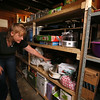 MaryBeth Bowen of Lowell, who has celiac disease, and the food, kitchenware and appliances she needs to eat a gluten-free diet. In this section of the basement she stores appliances that only she uses. (SUN/Julia Malakie)