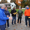 Volunteers pick up flyers to distribute to solicit donations for State Rep. Tom Golden's Halloween Food Drive Spooktacular, at Golden's house in Lowell. From left, Tom Golden with volunteers Amie Searles of Lowell, Miguel Gonzalez of Dracut, David Burns of Lowell, and Jeff Thomas of Lowell, all with Laborers' Local 429. (SUN/Julia Malakie)