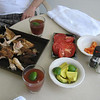 At the Mauna Lani Hotel:  huli-huli chicken, avocado, farmer's market tomatoes, papaya, and a fruity drink with rum in it.  I bet we were watching the whales too.  Feb. 2010