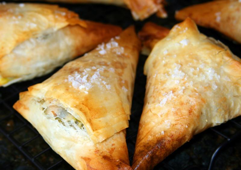 "Spanakopitas<br /> <br /> Ina Garten's recipe - <a href=""http://www.foodnetwork.com/recipes/ina-garten/dinner-spanakopitas-recipe/index.html"">http://www.foodnetwork.com/recipes/ina-garten/dinner-spanakopitas-recipe/index.html</a>"