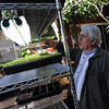 "Karim Amirfathi,  owner of Altan Alma in Louisville, talks about the lighting for the microgreens grown in his greenhouse.<br /> For more photos and a video on planting greens, go to  <a href=""http://www.dailycamera.com"">http://www.dailycamera.com</a>.<br /> Cliff Grassmick/ February 23, 2011"