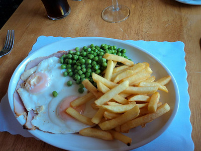 "Ham & Eggs - sliced honey roasted ham, served with a brace of fried eggs, chips & peas. £8.95.  Served in ""The Babbacombe Inn"" in Torquay  05/07/14"