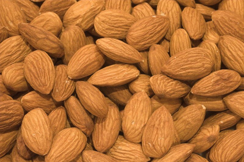 Almonds. High resolution photo made with Macro 50mm f/2.8 1:1 lens. This image will make nice decoration or illustration for publish.<br /> Image is copyrighted by Stan Pustylnik.