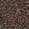 Dark brown beans in still life macro protograph made with 50mm f/2.8 1:1 lens. This photo can be purchased for decoration or monitor