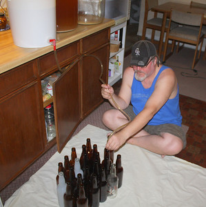Filling the bottles..one by one then cap.