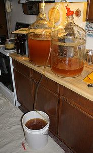 Drain brew into second container that has a corn sugar solution added.  This solution will carbonate the beer in the bottles.