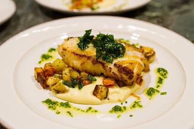 Seared halibut, rainbow carrots, parsnip puree, crispy basil, chive oil
